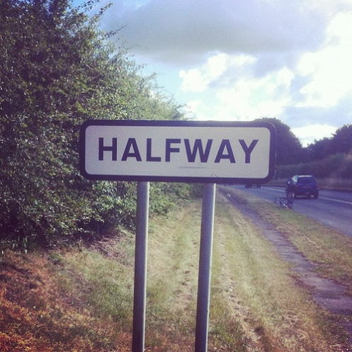 Halfway- the point where it would take just as long to go back as to go forward.