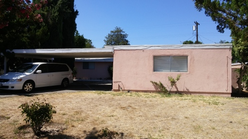 "Nothing says ""Home Sweet Home"" like pink stucco."